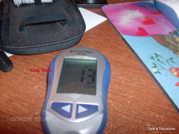 picture of Aviva meter with low blood sugar of 13