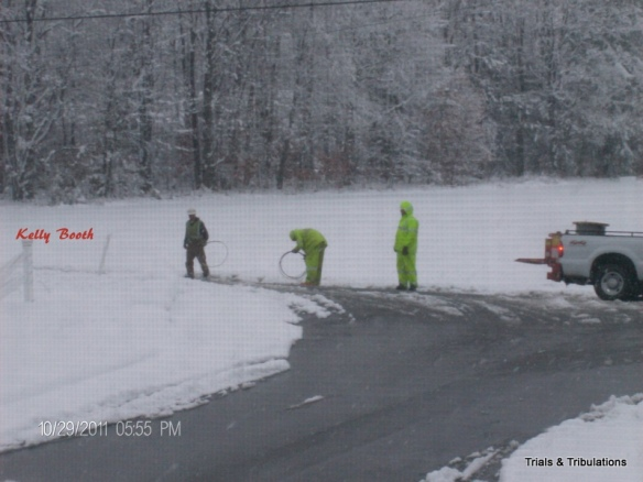 Penelec workers with wires in Nor'Easter